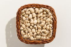 Black Eyed Pea legume. Top view of grains in a basket. Close up. Stock Photos