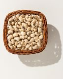 Black Eyed Pea legume. Wicker basket with grains. Top view, hard Stock Images