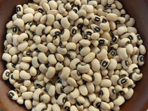 Black Eyed Peas. Close up of raw black eyed peas in wooden bowl Royalty Free Stock Images