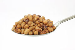 Black eyed peas on large serving spoon Stock Photos