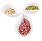 Black Eyed Peas, Mung, Azuki Bean III. Black eyed peas, mung bean, azuki bean in ceramic bowls Royalty Free Stock Images