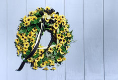 Black Eyed Susan Wreath. Small yellow flowers and black and yellow ribbon make up this wreath Royalty Free Stock Photos