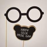 Black eyeglasses and text happy geek pride Stock Images