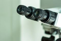 Black eyepieces of the microscope in the laboratory for viewing small items. Close-up. royalty free stock image