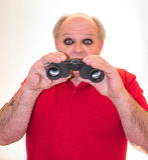 Black Eyes Practical Joke. An older man with a pair of binoculars suffering the classical black-eye practical joke royalty free stock photos