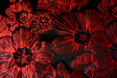 Black fabric with big scarlet red flowers. From above Stock Photo