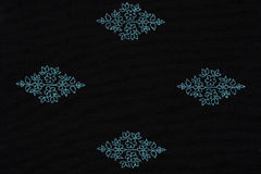 Black fabric with blue pattern, a background or texture Royalty Free Stock Images