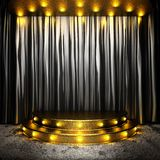 Black fabric curtain on golden stage Royalty Free Stock Photography