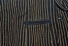 Black fabric with golden stripes Royalty Free Stock Photos