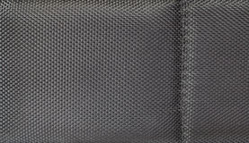 Black fabric grid texture Stock Images