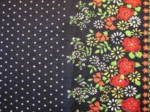 Black fabric with painted flowers Stock Photos