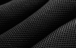 Black fabric pattern. Black fabric pillow pattern with holes Stock Photography