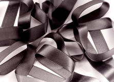 Black Ribbon. A closeup of a black ribbon isolated on white Stock Images