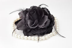 Black fabric rose and necklace Stock Photography