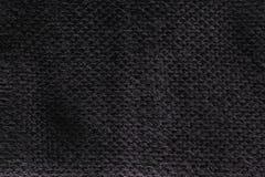 Black fabric textile texture background Stock Image