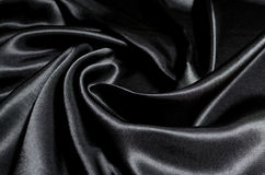 Black Fabric Texture Background. The folds of fabric stock illustration