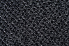 Black fabric texture with pattern, with sagging inside the ovals. The texture of the fabric. Closeup Stock Images