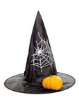 Black fabric witch hat with pumpkin for Halloween Royalty Free Stock Photography