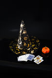 Black fabric witch hat, pumpkin isolated on black background Royalty Free Stock Photo
