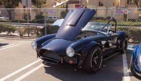 Black 1964 Factory Five 289 Shelby Cobra. Laguna Beach, CA, USA - October 2, 2016: Black 1964 Factory Five 289 Shelby Cobra owned by Erik Hansen and displayed at stock photo