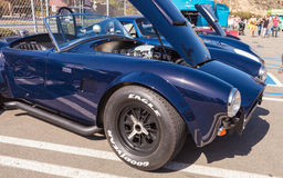 Black 1964 Factory Five 289 Shelby Cobra. Laguna Beach, CA, USA - October 2, 2016: Black 1964 Factory Five 289 Shelby Cobra owned by Erik Hansen and displayed at royalty free stock photo