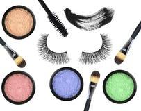 Black false eyelash, mascara, eyeshadows and brushes isolated Stock Photos