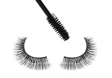 Black false eyelash and mascara isolated on white Stock Images