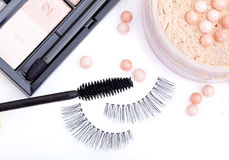 Black false eyelashes with mascara and powder Royalty Free Stock Image
