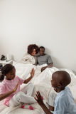Black family in the bed Royalty Free Stock Image