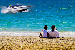 Black family dreams of a fast boat Stock Photography