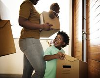Black family moving in to new house stock photos