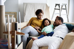 Black family moving in to their new house stock photos