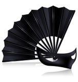 Black fan and dark mask Royalty Free Stock Photo