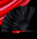 Black fan, red drape and and petals Stock Photo