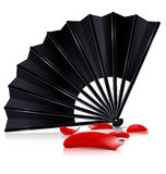 Black fan and red petals Royalty Free Stock Photos