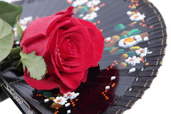 Black fan and red rose Royalty Free Stock Photos