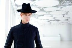 Black far west modern fashion man with hat Stock Photos