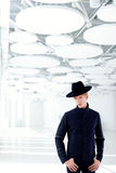 Black far west modern fashion man with hat Stock Images