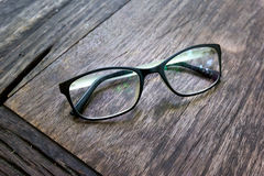 Black fashion glasses on wood background Royalty Free Stock Photos