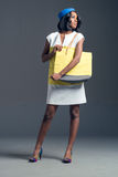 Black fashion model wearing stylish flight attendant wardrobe Stock Photo