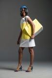 Black fashion model wearing stylish flight attendant wardrobe Stock Photos