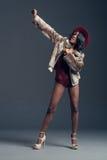 Black fashion model wearing stylish wardrobe Royalty Free Stock Photos