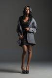 Black fashion model wearing stylish wardrobe Stock Images