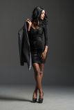 Black fashion model wearing stylish wardrobe Stock Photo