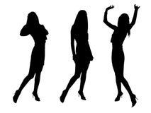 Black fashion sexy girls. Silhouettes stand three white women people Stock Photos
