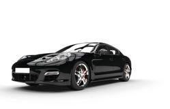 Black Fast Car - Studio Shot. Black fast car isolated on white background Stock Photography