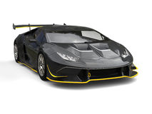 Black fast race car with yellow details Stock Photos