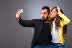 Black father taking selfie with his daughter Royalty Free Stock Images