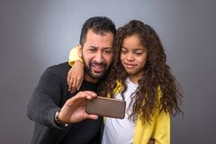Black father taking selfies with his daughter Royalty Free Stock Image