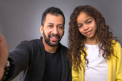 Black father taking selfies with his daughter Stock Images